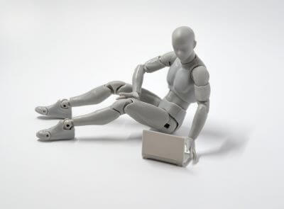 Artist's articulated model with laptop